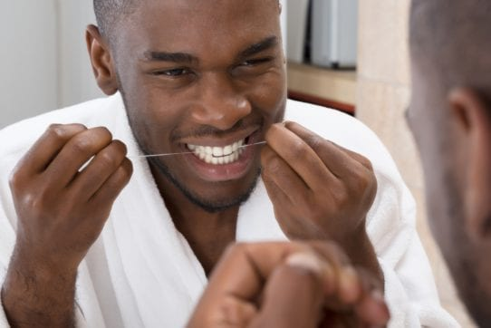 taking care of gums with flossing
