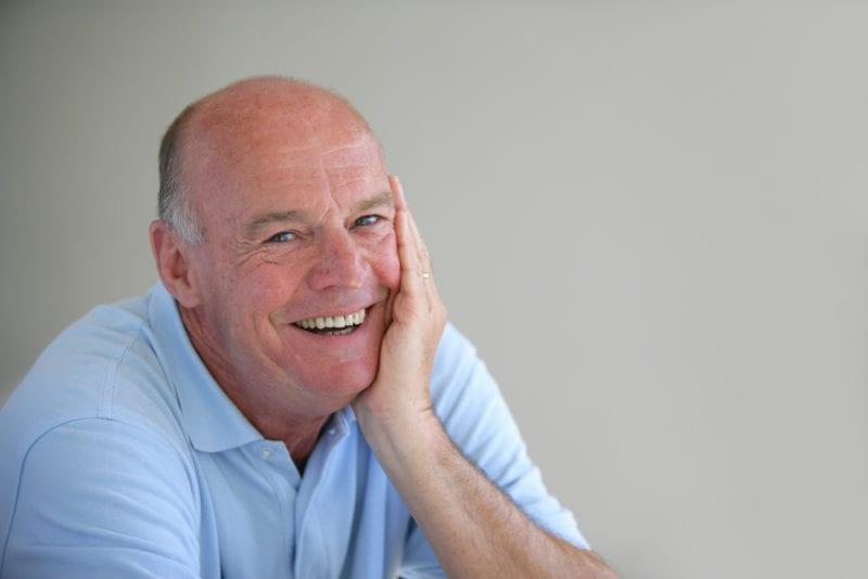 A smiling elderly man